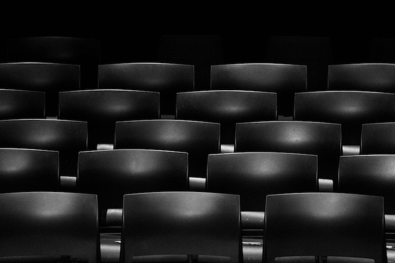 black and white photo of seats in a lecture theatre
